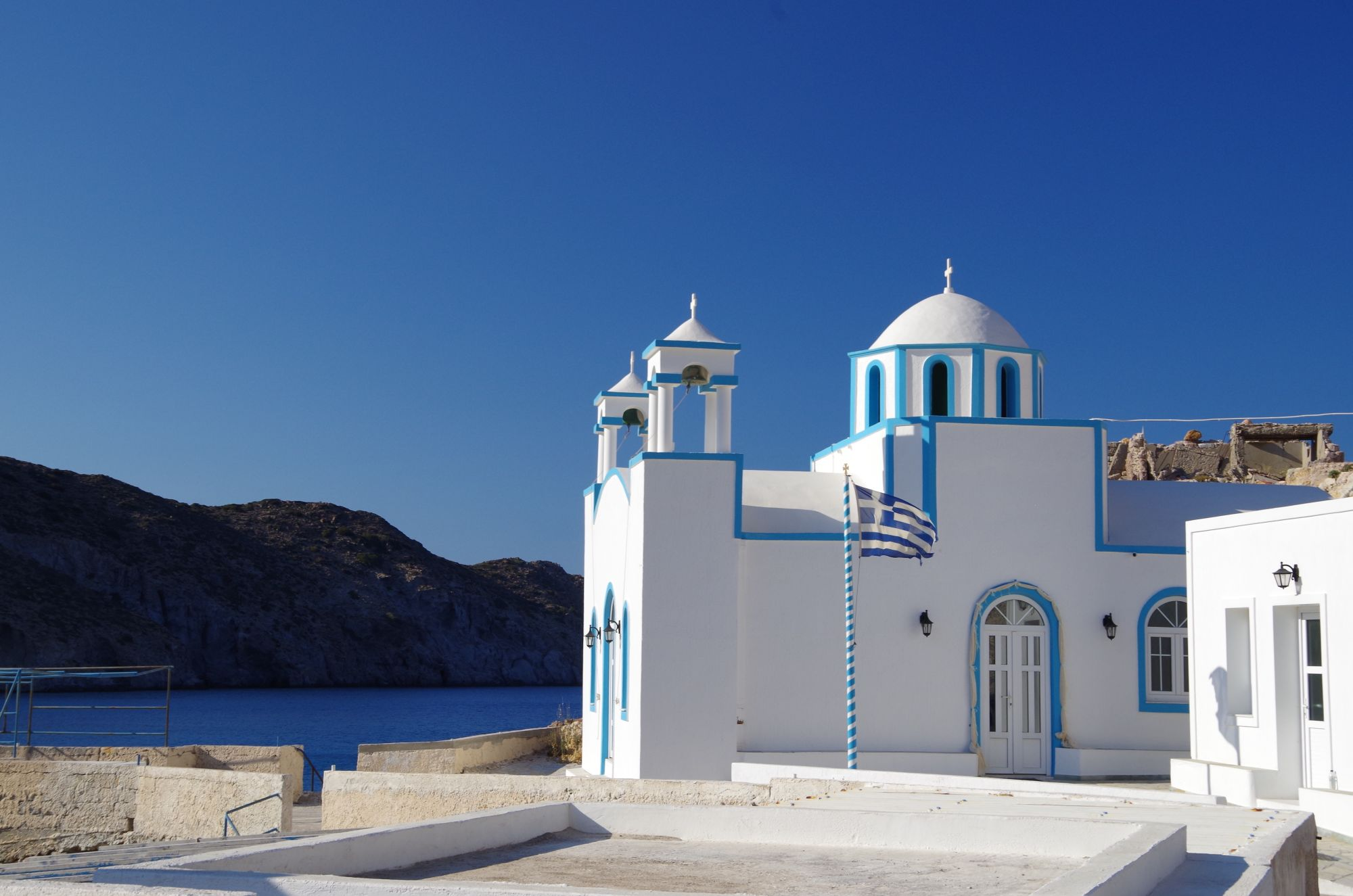 Islands of the Greek Cyclades Tours 2019 - 2020 -  Blue and white church in Greece
